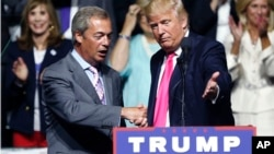 FILE - Then Republican presidential candidate Donald Trump welcomes Nigel Farage (L), leader of the British UKIP party, at a campaign rally in Jackson, Missouri, Aug. 24, 2016.