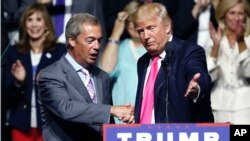 FILE - Aug. 24, 2016 file photo of Republican presidential candidate Donald Trump, right, welcoming pro-Brexit British politician Nigel Farage, to speak at a campaign rally in Jackson, Miss. Britain's vote to leave the European Union was a major shock to the global political system. But in a year of political earthquakes, it has just been trumped. Like Brexit, Donald Trump's victory over Hillary Clinton in the U.S. presidential election was driven by voters turning against established order and mainstream politicians.