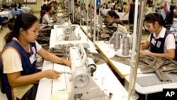Cambodian garment workers sew clothes in a factory in Phnom Penh.