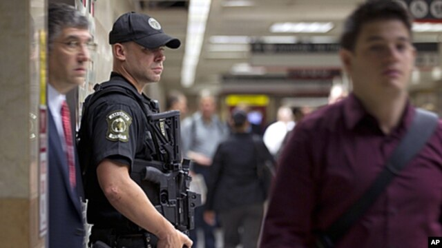 An Amtrak police officer stands guard at a track entrance at Pennsylvania Station in New York, on September 9, 2011.