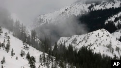 Fog and mist shroud the Sierra Nevada near Echo Summit, Calif., Feb. 2, 2017. Three January blizzards left snowpack 173 percent above average in the mountains.
