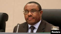 "Ethiopia's Prime Minister Hailemariam Desalegn, shown here at an Extraordinary Summit of Intergovernmental Authority on Development (IGAD) Heads of State on Jan. 31, 2014, says IGAD member states ""will take action"" if South Sudan fails to respect the blueprint signed Aug. 26, for creating a transitional government and restoring peace."