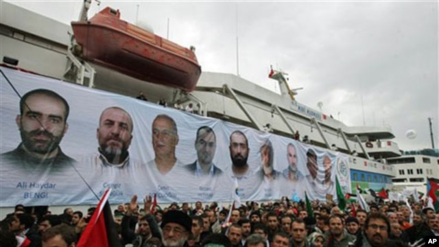 A banner depicting the faces of the nine men killed, displayed on the Mavi Marmara ship, the lead boat of a flotilla headed to the Gaza Strip which was stormed by Israeli naval commandos in a predawn confrontation in the Mediterranean May 31, 2010, on its