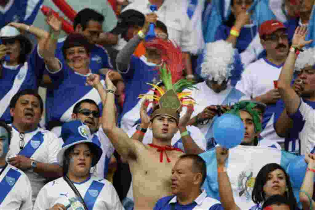 Guatemala soccer fans cheer their team in a U-20 World Cup Group D soccer match against Nigeria in Armenia, Colombia, Sunday,July 31, 2011. (AP Photo/Fernando Vergara)