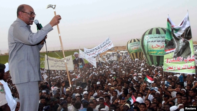 President Omar Hassan al-Bashir addresses a crowd in North Khartoum, June 8, 2013.