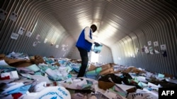 A staff member of the World Food Program (WFP) examines on Aug. 18, 2016 the remains of the logistic base of the United Nations (UN) organization in the Jebel district in Juba, after it was looted during clashes between Government and opposition forces between July 8 and July 11.