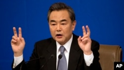 China's Foreign Minister Wang Yi speaks at a press conference in Beijing, March 8, 2015.