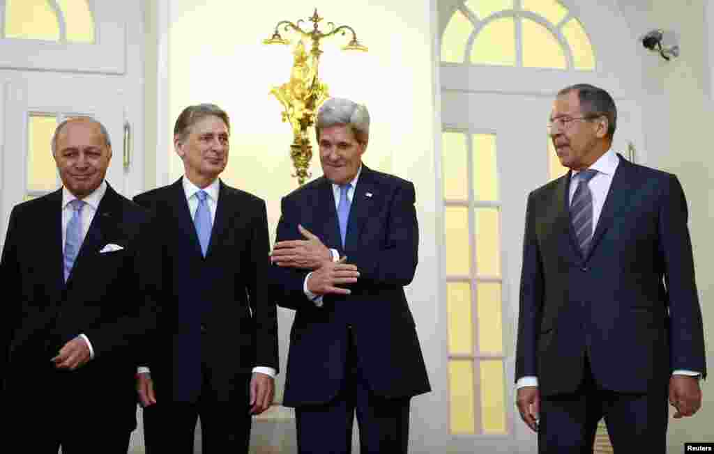 French Foreign Minister Laurent Fabius, Britain's Foreign Secretary Philip Hammond, U.S. Secretary of State John Kerry and Russian Foreign Minister Sergei Lavrov pose for photographers before a meeting in Vienna, Nov. 24, 2014.