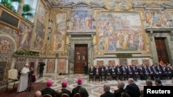 "Pope Francis (L) makes his ""State of the World"" address during an audience with the diplomatic corps at the Vatican, Jan. 13, 2014."
