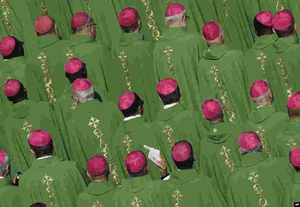 Bishops attend a Mass celebrated by Pope Francis for the opening of a synod in St. Peter's Square at the Vatican.
