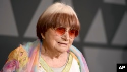 "FILE - Filmmaker Agnes Varda arrives at the 9th annual Governors Awards in Los Angeles, Nov. 11, 2017. Varda shares the documentary feature Oscar nomination for ""Faces Places"" with her co-director, JR, and her producer daughter, Rosalie Varda. She received an honorary Academy Award in November recognizing her decades of filmmaking."