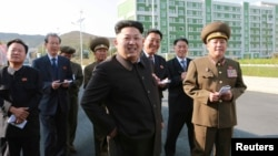 FILE - North Korean leader Kim Jong Un gives field guidance at the newly built Wisong Scientists Residential District in this undated photo released by North Korea's Korean Central News Agency (KCNA) in Pyongyang.