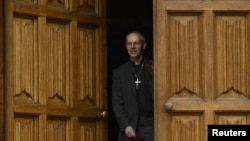 The Bishop of Durham, and the newly appointed Archbishop of Canterbury, Justin Welby, leaves after a news conference at Lambeth Palace, in London, November 9, 2012.