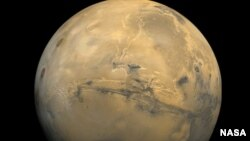 The largest canyon in the Solar System cuts a wide swath across the face of Mars. Named Valles Marineris, the grand valley extends more than 3,000 kilometers long, spans as much as 600 kilometers across, and delves as much as 8 kilometers deep. (Viking Project)