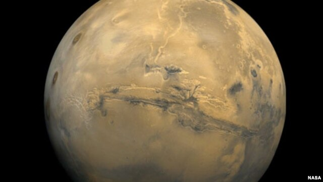 The largest canyon in the Solar System cuts a wide swath across the face of Mars.(NASA)