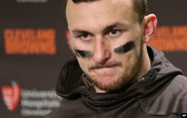 FILE - Cleveland Browns quarterback Johnny Manziel speaks with reporters.