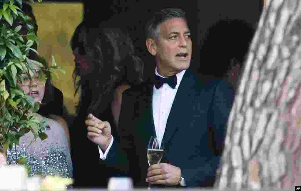 George Clooney attends a cocktail with guests at the Cipriani hotel ahead of his wedding with Amal Alamuddin in Venice, Sept. 27, 2014.