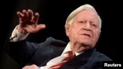 "FILE - Former West German Chancellor Helmut Schmidt gestures during his speech at his 95th birthday party, organized by German weekly magazine ""Die Zeit,"" in a theater in Hamburg, Jan. 19, 2014. Schmidt died Nov. 10, 2015."