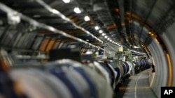 FILE - View of the Large Hadron Collider (LHC) in its tunnel at CERN (European particle physics laboratory) near Geneva, Switzerland.