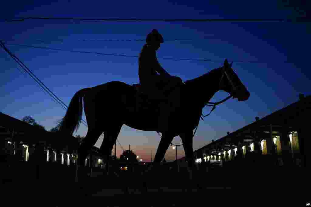 A jockey heads back to the barns at Churchill Downs in Louisville, Ky. The 147th running of the Kentucky Derby is scheduled for May 1.