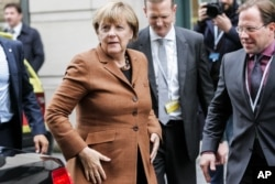 German Chancellor Angela Merkel arrives for a European Peoples Party , EPP , meeting, ahead of an emergency EU heads of state summit on migration, in Brussels on Sept. 23, 2015.