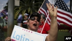 """Supporters of US President Donald Trump rally outside the """"Latinos for Trump Roundtable"""""""