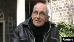 An undated photo released April 7, 2014 by anti-government activist group Syrian Observatory for Human Rights, which has been authenticated, shows Dutch Father Francis Van Der Lugt in Homs, Syria.