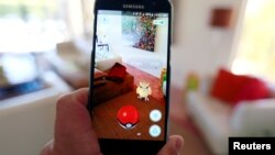 "The augmented reality mobile game ""Pokemon Go"" by Nintendo is shown on a smartphone screen in this photo illustration taken in Palm Springs, California U.S. July 11, 2016."