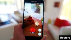 "FILE - The augmented reality mobile game ""Pokemon Go"" by Nintendo is shown on a smartphone screen in this photo illustration taken in Palm Springs, California, July 11, 2016."