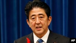 Japan's Prime Minister Shinzo Abe speaks on a sales tax hike during a press conference at the prime minister's official residence in Tokyo, Oct. 1, 2013.