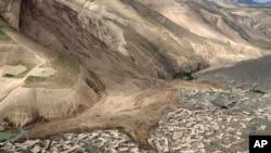 An ariel view shows site of Friday's landslide that buried Abi Barik village in Badakhshan province, northeastern Afghanistan, May 5, 2014.