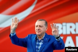 FILE - Turkey's President Tayyip Erdogan greets people at the United Solidarity and Brotherhood rally in Gaziantep, Turkey, Aug. 28, 2016.