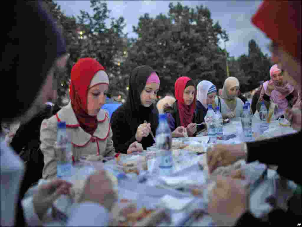 Women break their fast at the end of the third day of Islam's holy month of Ramadan in the central Bosnian town of Zenica.