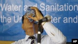 A Cambodian Municipality of Phnom Penh Deputy Governor Mann Chhoeun drinks water at the celebration of an annual World Water Day at Chroy Chang Va primary school in Phnom Penh, Cambodia, on Tuesday.