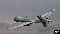 Беспилотный самолет MQ-9 Reaper, вооруженный ракетами Hellfire, используемый для проведения операций в Афганистане и Пакистане.