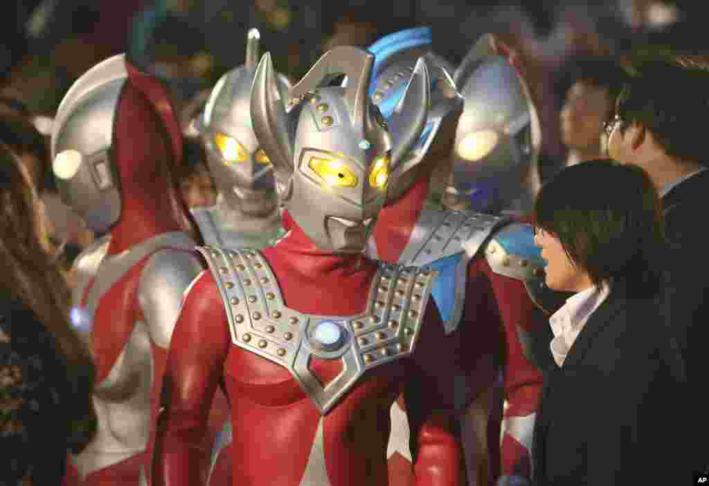 People dressed as Japanese TV character Ultra Seven walk on the red carpet during the opening ceremony of the 27th Tokyo International Film Festival in Tokyo, Japan.