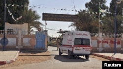An ambulance enters an hospital located near the gas plant where hostages were kidnapped by Islamic militants, in Ain Amenas, January 19, 2013.