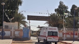 An ambulance enters an hospital located near the gas plant where hostages have been kidnapped by Islamic militants, in Ain Amenas, January 19, 2013.