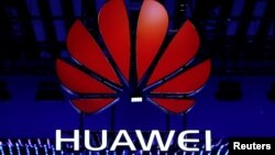 FILE - The Huawei logo is seen during the Mobile World Congress in Barcelona, Spain, Feb. 26, 2018.