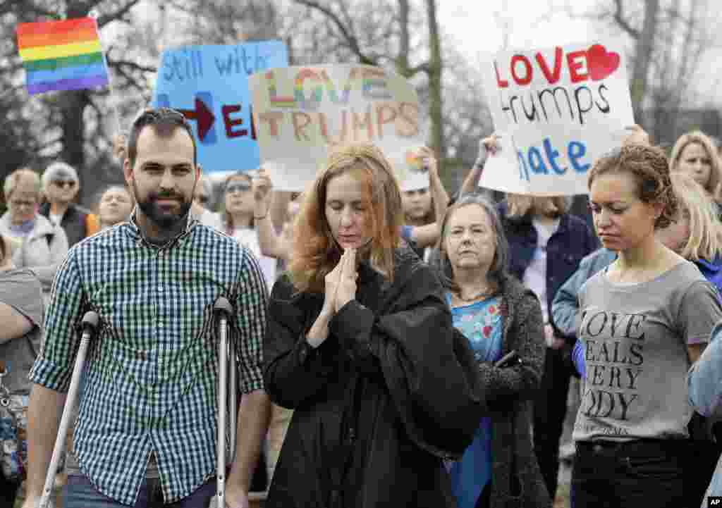 People take part in a protest organized to combat harsh rhetoric by Donald Trump in Nashville, Tenn., Jan. 20, 2017.