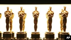 FILE - Oscar statuettes appear backstage at the Oscars in Los Angeles, Feb. 26, 2017.