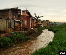 Irrigation ditches built to close to homes often lead to flooding in low lying homes. (E. Paulat/VOA)