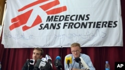 FILE - The general director of medical charity, Medecins Sans Frontieres (MSF), Christopher Stokes, right, talks as MSF's Guilhem Molinie, left, listens, during a press conference, in Kabul, Afghanistan, Oct. 8, 2015.