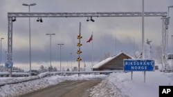 A sign at the entrance of the border post informs travelers that they are entering Norway, Feb. 8 2019. Norway's membership in the European Economic Area grants it access to the common market and most goods are exempt from paying duties but everything entering must be declared and cleared through customs.