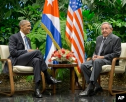 FILE - President Barack Obama meets with Cuban President Raul Castro at the Palace of the Revolution, Monday, March 21, 2016 in Havana, Cuba.