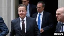 British Prime Minister, David Cameron leaves 10 Downing Street in London, Britain, Sept. 7, 2015. Cameron will address Parliament on Britain's response to the migrant crisis in Europe.