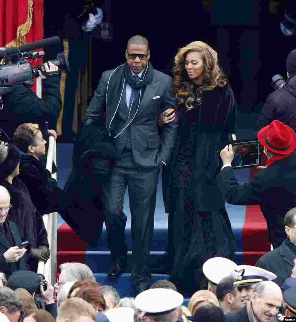 Recording artists Beyonce (R) and Jay-Z arrive ahead of the swearing-in ceremonies for U.S. President Barack Obama on the West Front of the U.S. Capitol in Washington, January 21, 2013