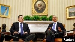 Presiden AS Barack Obama dan PM Tunisia Mehdi Jomaa dalam konferensi pers di Kantor Oval, Gedung Putih, Washington DC (4/4).