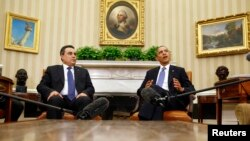 President Barack Obama and Tunisia's Prime Minister Mehdi Jomaa speak to the press in the Oval Office of the White House in Washington, April 4, 2014.