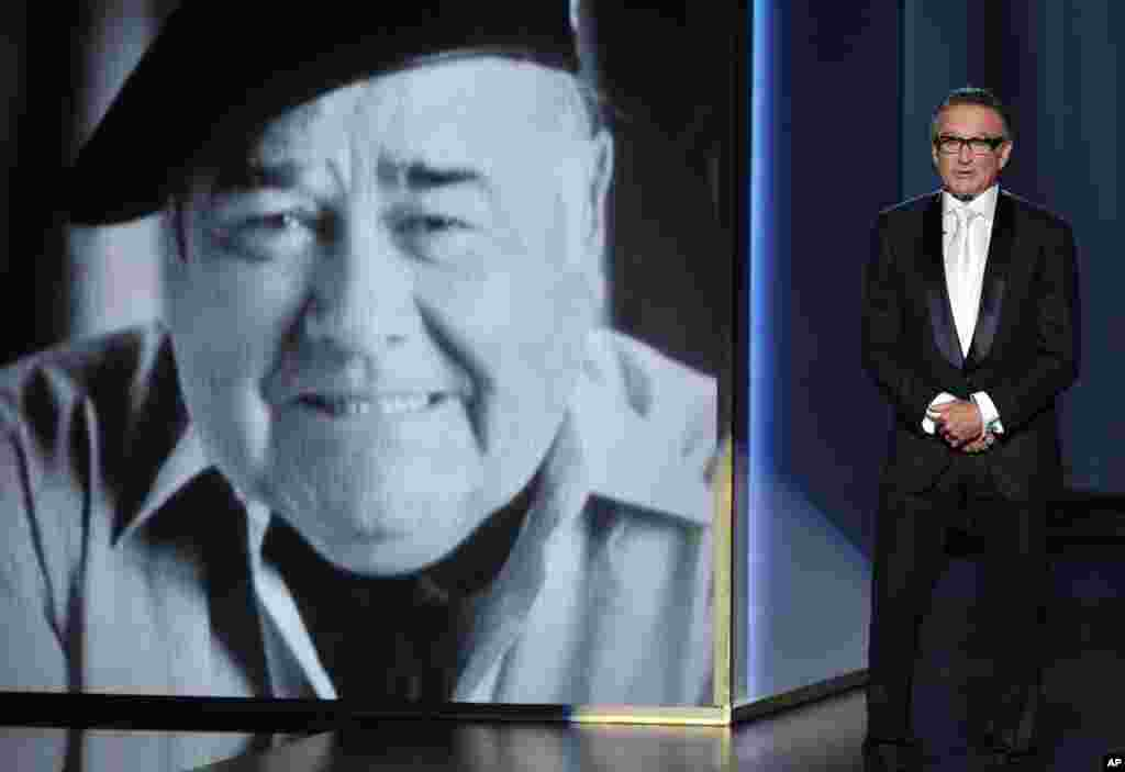 Robin Williams presents a tribute to Jonathan Winters on stage at the 65th Emmy Awards at Nokia Theater, Sept. 22, 2013, in Los Angeles. (